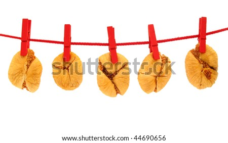 Dried figs drying on clothes line