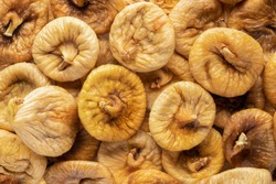 dried figs, top view. texture background for articles about healthy eating and proper lifestyle.