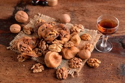 Dried figs with nuts and wine on table