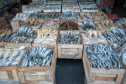 dried fish in boxes on a market