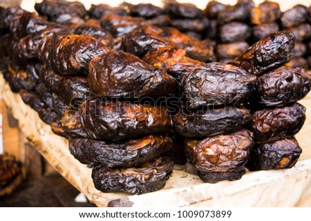 Dried fish rolled up ans stacked in Nigerian local market popular for soups and other dishes