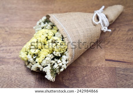 Dried flower bouquet on wood table