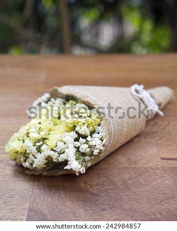 Dried flower bouquet on wooden table