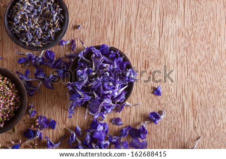 Dried flower petals: scented lavender, heather and larkspur. Copy space.