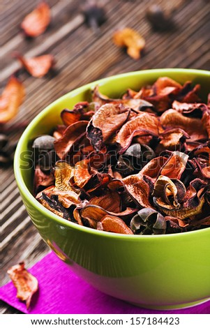 dried flowers in a bowl on the table