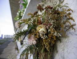 Dried flowers in cemetery niches, Catholic death, symbol