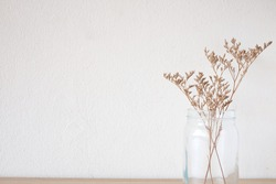 Dried Flowers in the Glass Jar for decoration with Empty Wall in Minimal Style