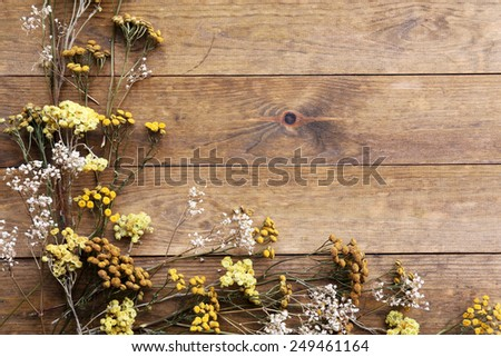 dried flowers on rustic wooden...
