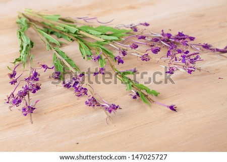 Dried flowers willow-herb on wooden table