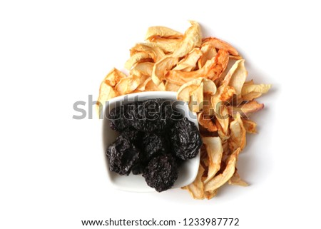 dried fruit, dried apples, dried apricots, walnuts on a white background