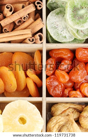Dried fruits and cinnamon in box close-up