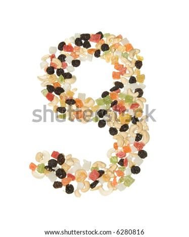 Dried fruits and nuts formed 9 digit isolated on white