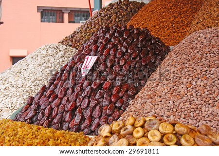 Dried fruits, figs, and nuts, in Moroccan market - stock photo