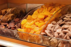 Dried fruits. Focus on apricots. Closeup picture