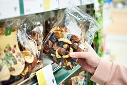 Dried fruits in a hand in a store