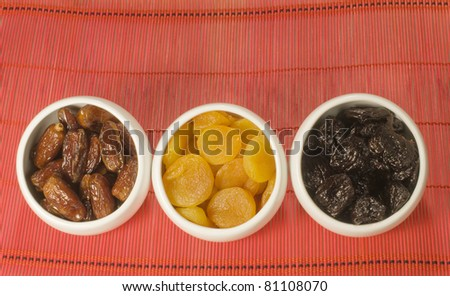 Dried fruits in white bowls