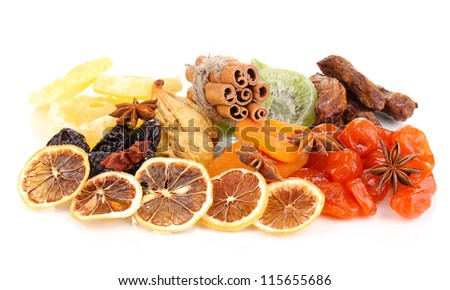 Dried fruits with cinnamon and anise stars isolated on white