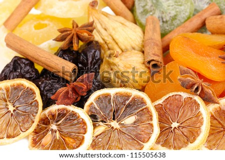 Dried fruits with cinnamon and star anise close-up