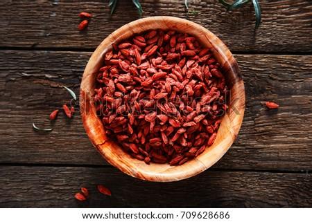 Dried goji berries on wooden background Stock fotó ©