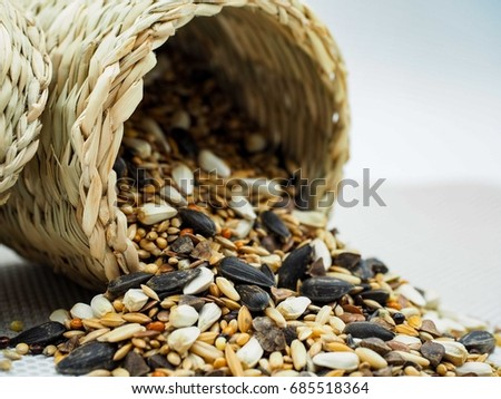 dried grains bird food, Black sunflower seeds are highly recommended for use in bird feeders because they attract a wide variety of birds, high ratio of meat to shell, and are high in fat content. #685518364