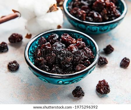 Dried grapes, raisins on a grey concrete background Stock photo ©