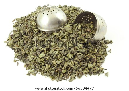 Dried green tea leaves with cup container isolated on white - stock photo