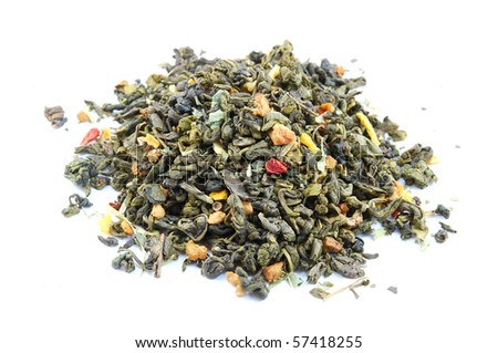 Dried green tea leaves with slices of strawberry and citrus