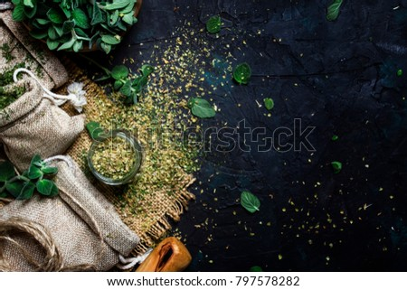 Dried ground oregano or marjoram, dark background, top view #797578282