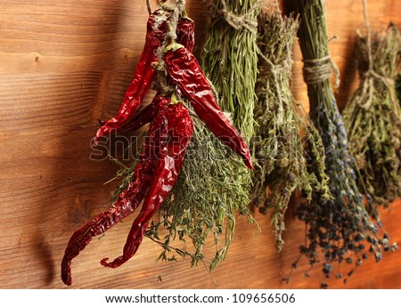 dried herbs and pepper, on wooden background
