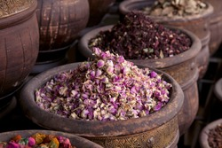 dried herbs flowers (rose) in the  Marrakesh street shop, shallow dof