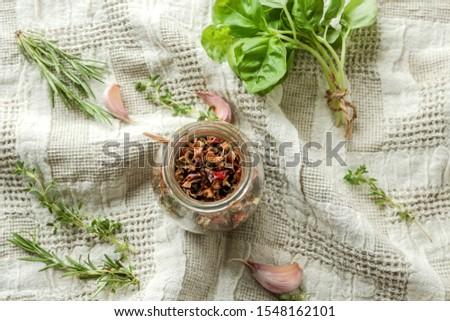 dried herbs, fresh herbs, garlic on a light background