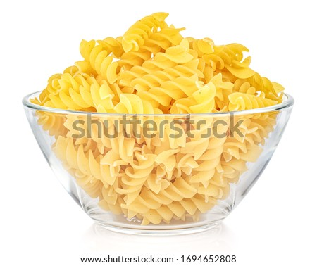 Dried italian pasta spiral Fusilli in a transparent glass round bowl isolated on white background Foto d'archivio ©