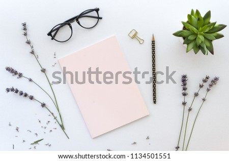 dried lavender around pink note and a black pencil on white background for your lettering. Top view, flat lay mockup