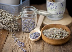 Dried lavender. Flowers, buds and a bouquet of lavender are used both in aromatherapy and in cooking. Lavender tea is a medicinal herb. Useful aromatic essential plant on a wooden background.