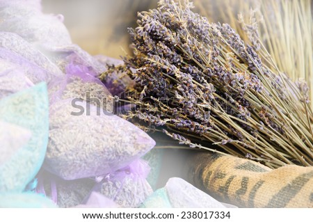 Dried lavender for sale in transparent  bags. Selective focus on dried flowers bunch over the rough  bag.