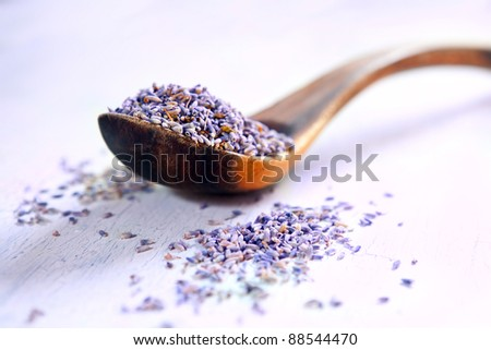 Dried lavender in a wooden spoon on a rustic table