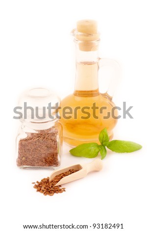 Dried linseed with macerated oil isolated on white