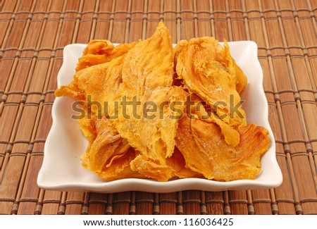 Dried  mango on white plate