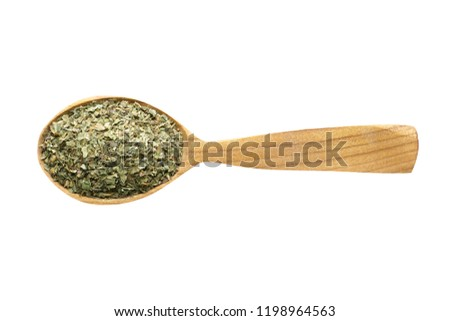 dried marjoram for adding to food. spice in wooden spoon isolated on white. seasoning of delicious meal. #1198964563