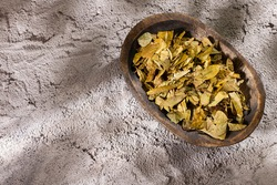 Dried medicinal coca leaves in the wooden bowl - Erythroxylum coca