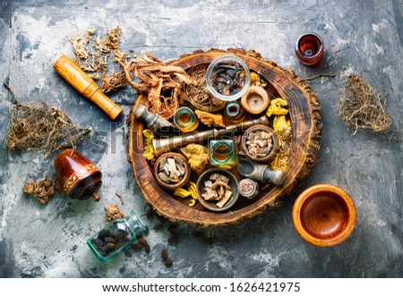 Dried medicinal herbs, plants and rhizomes in wooden tray.Natural medicine