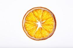 Dried orange isolated on a white background. Dried orange slice macro