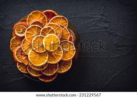 Dried oranges on black stone background #231229567