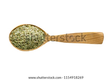dried oregano for adding to food. spice in wooden spoon isolated on white. seasoning of delicious meal. #1154918269