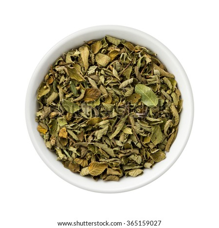 Dried Oregano Leaves in a Ceramic Bowl. The image is a cut out, isolated on a white background, with a clipping path. #365159027