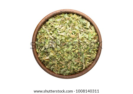 dried oregano seasoning in a wooden bowl, top view. spice isolated on white #1008140311