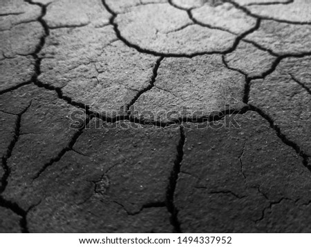 Dried out, cracked and textured residue of cooked grounded coffee in black and white. May also symbolise soil, ground, dirt etc. #1494337952