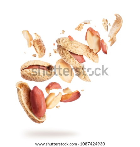 Dried peanuts crushed into many pieces close-up on white background