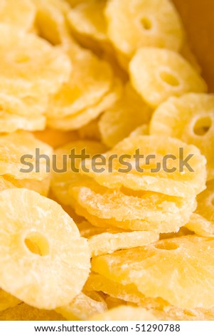 Dried pineapple (ananas) slices in the candy shop.