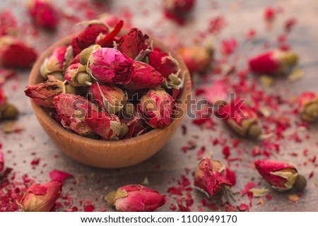 Dried Pink Rose Buds in a Brown Bowl